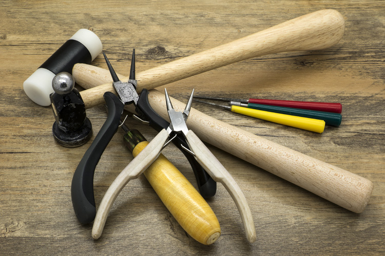 Jewelry tools: get a mallet, a chasing hammer, French shears, side cutters, and pliers